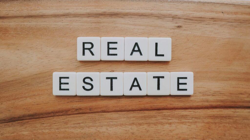 Real Estate spelled in tile