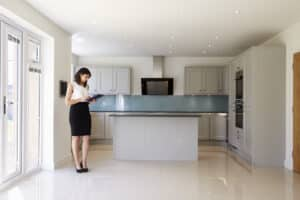 Female Realtor Looking at Lease in Kitchen