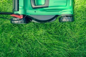 Lawn mower mowing a lawn