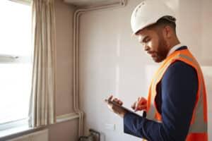 surveyor conducting a home inspection